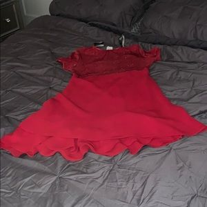 Red Spanish cocktail style dress.